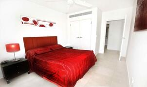Second Bedroom With Queen Bed And Walk In Wardrobe