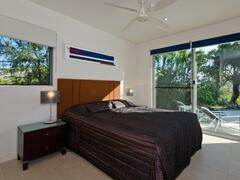 Third Bedroom With Double Bed And Access To Fenced Pool Via Sliding Door