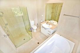 Second Bathroom With Shower And Large Bath