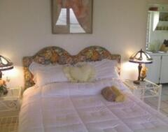 Tropical Garden Suite Accommodates up to 4 people.