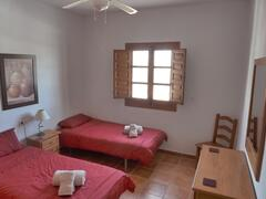 One of the twin bedrooms