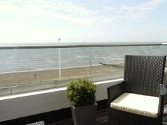 Property Photo: Old Chelsea Balcony Looking at the Beach!
