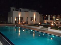 Property Photo: Stunning pool by night.