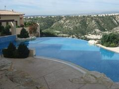 Property Photo: Breath taking views across stunning communal ifinity pool!