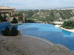 Property Photo: Breath taking views across stunning communal ifinity pool!
