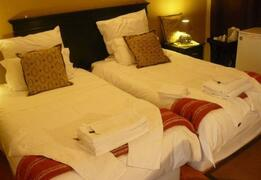 Property Photo: Single beds in the Standard Room
