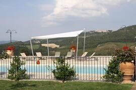 Large pool terrace with sun sail