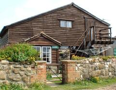 Property Photo: Cabin Barn conversion - old stone barn with wooden top!