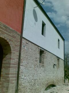 Property Photo: Close up of the stone walls of the house