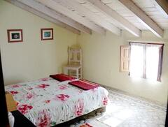 One of the double bedrooms with original tiled flooring