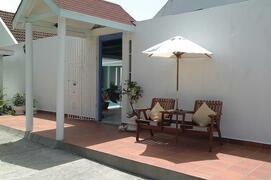 Property Photo: Exterior Elevation & Patio Area