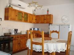 Property Photo: The fully equipped kitchen with brand new appliances