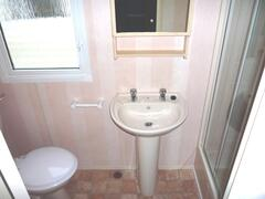 bathroom showing large shower cubicle to the right