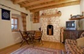 Property Photo: Living room with fire place and pine beams