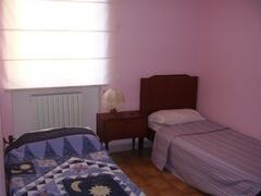 small room with three single beds