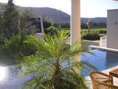 Property Photo: Bamboo Cottage, swimming pool and view of the mountains