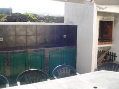 Backyard BBQ,outdoor kitchen, Casa da Barca.  Large tiled backyard with plenty of space for outdoor entertaining