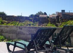 backyard courtyard  view of vinyard, Casa da Barca.  plenty of outdoor furniture for outdoor living.