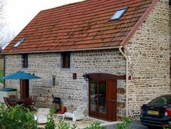 Property Photo: The barn, patio and large garden. Offroad parking, quiet location