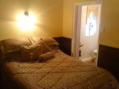 The old snug is now home to a double bedroom with ensuite wc.