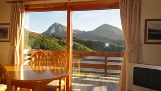 Property Photo: View through patio windows at Kylesku Lodges