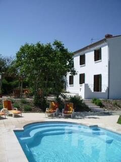 Property Photo: The South facing terraces and pool