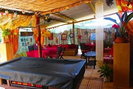 Property Photo: chill out lounge/bar and BBQ terrace with music, games, pool table and table football, Darts, books
