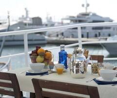 Property Photo: Breakfast on deck, while enjoying the view with super yachts in the marina