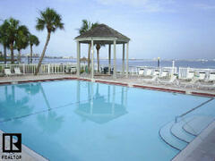Property Photo: Front Pool On Private Bay Beach