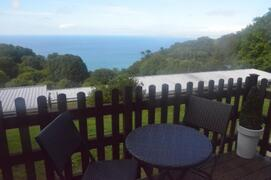 Property Photo: The balcony, a place to relax and soak up the breathtaking views of the coastline.