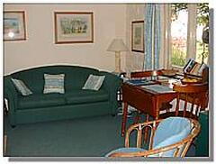Cosy guest lounge is adjacent to carport, t.v., fridge, all crockery and cutlery needs.