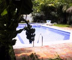 Property Photo: Well-maintained heated pool and spa
