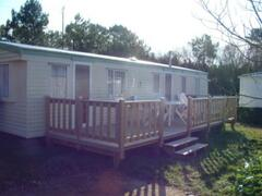 Property Photo: The mobile home and decking