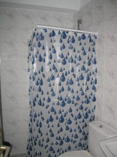 bathroom with shower and washine machine