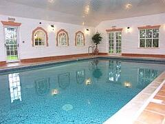 Property Photo: Indoor Pool with Sauna, Steam Room and Gym