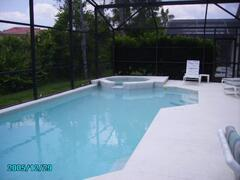 Property Photo: Large pool & HOT tub w/extended decking