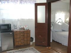 Mini-fridge, microwave, coffee maker & electric kettle