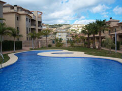 Property Photo: Swimming pool and gardens