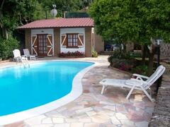 the cottage in front of the pool
