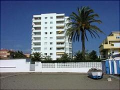 Property Photo: The apartment is adjacent to the beach-complete with beach bar/restaurant