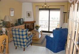 Property Photo: The comfortable living area has patio doors to the balcony with spectacular views