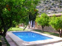 Property Photo: View of holiday cottage and pool