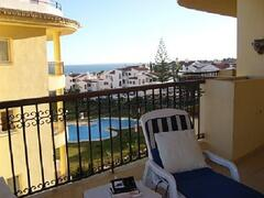 Balcony view of gardens & pool