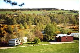 Property Photo: Chalet and caravan look over the loch
