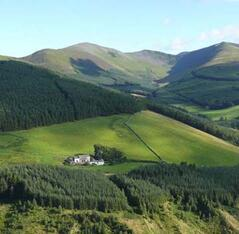 Property Photo: Darling How with Grizedale Pike and Hopegill Head behind.