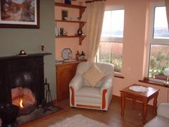 The cosy lounge with open fire and views over Kenmare Bay