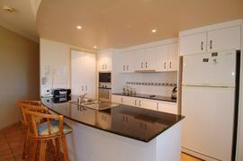 Modern kitchen with dishwasher, pantry & full oven