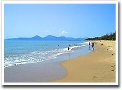 Relax on this sandy beach 15 minutes from Cairns